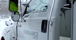 Close up photo of an Eversource line truck