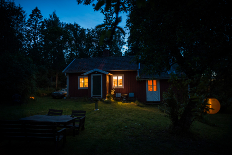 A home at dusk with lights on