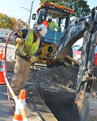 Eversource gas crews perform maintenance work in Hyde Park.
