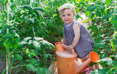 little-girl-watering-garden
